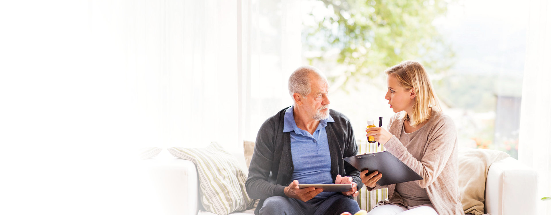 caregiver having a discussion with her senior patient