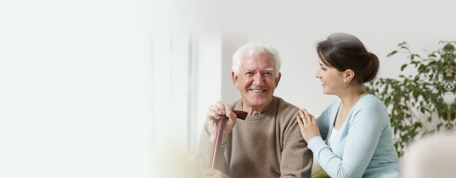 senior patient with his caregiver