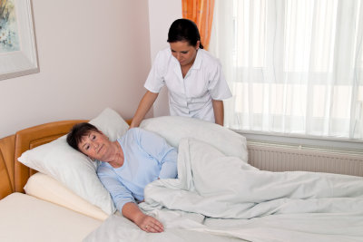 caregiver caring the sick senior woman