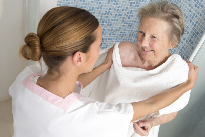 caregiver assisting senior woman for shower at home